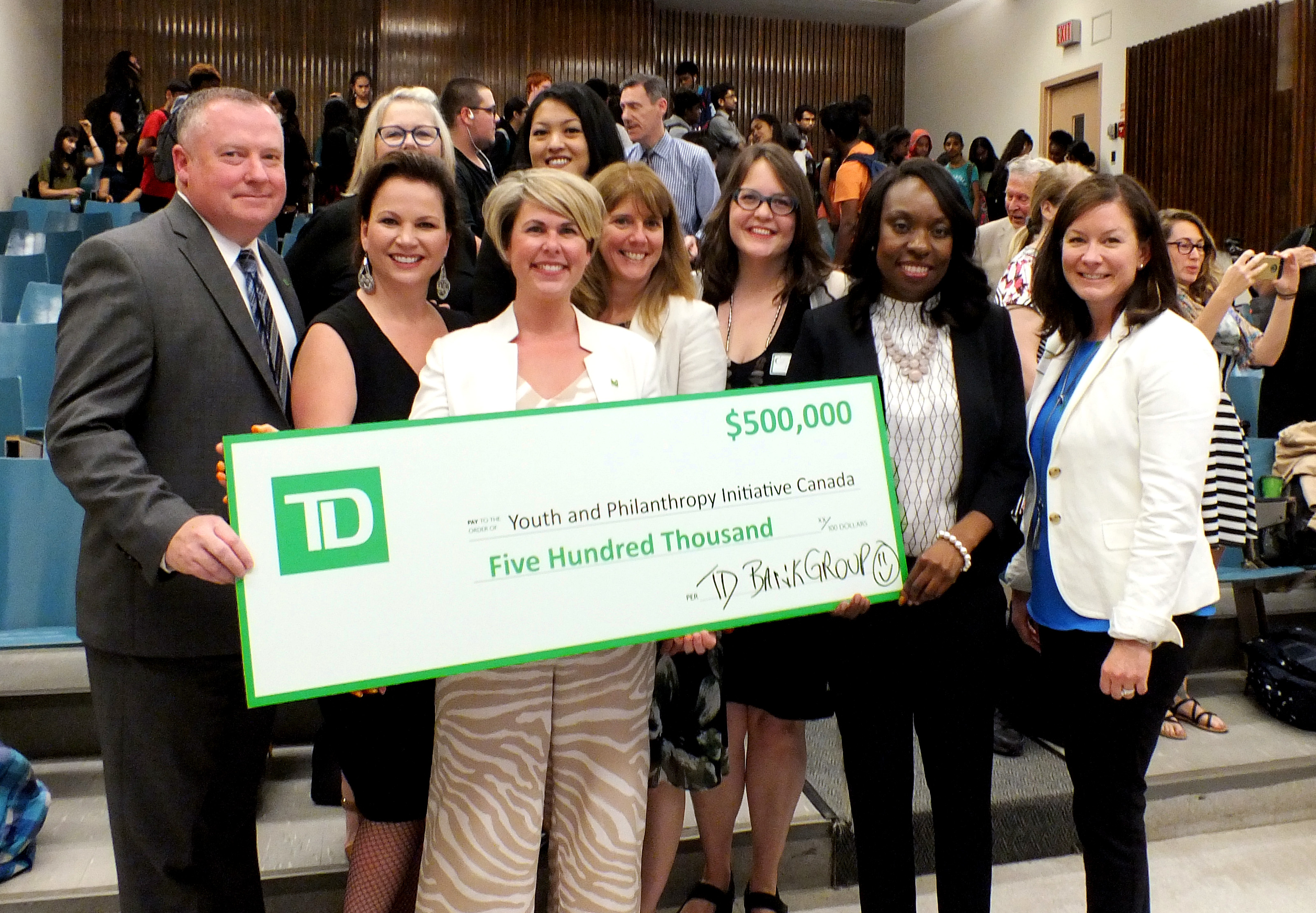 Members of the TD Bank Group present YPI staff and board with a cheque for $500,000