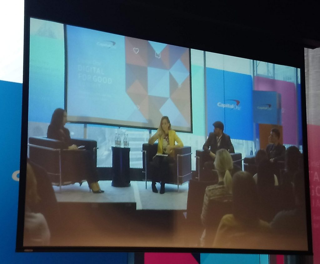 Two women and two men seated on stage as a panel discussion